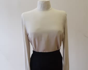 "1980s, 38"" bust, off white silk crepe, long sleeved Armani blouse."
