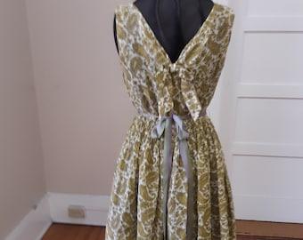 1950s  38 bust, open neckline, sleeveless sun dress