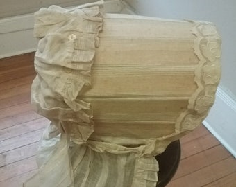 "1850's, 8"" wide, 10""deep, wood and striped muslin bonnet."