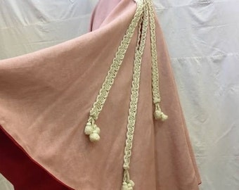 """1950s, 24"""" waist, full circle skirt of pink linen over a lining of bright red taffeta."""