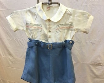 """1930s, 18"""" chest, boy's (2 years) rompers  of white satin top buttoned on to powder blue cotton shorts."""
