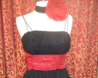 "1950's. 3 6"" bust, black silk ""cocktail dress""with gold dotted red cummerbund."
