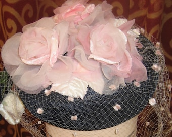 "1950's, 22"" round, hat of midnight blue silk, with pink silk roses atop of crown."