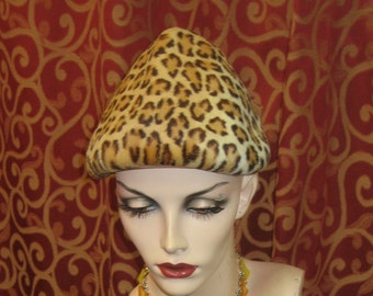 "1950's, 22"" round, cone shaped hat, of rabbit fur stenciled leopard"