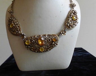 "1930's, 16 1/2"" long, three part metal gold toned necklace, encrusted with beveled oval shaped amber glass stones"