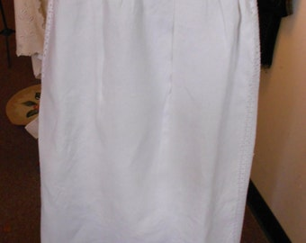 1890's, adjustable waist, full length white linen apron