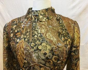 "1970s, 36"" bust, elaborate  black and gold brocade dress coat"