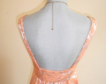 "1960's, 32"" bust, coral satin brocade, ""empire"" style gown with low back."