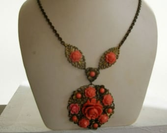 1930's brass and coral carved colloid flower necklace
