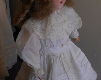 "1900, 21"" tall, German bisque headed doll, with composition doll."