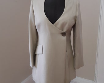 "1980s, 34"" bust, tan wool gabardine iong jacket with low open neckline"