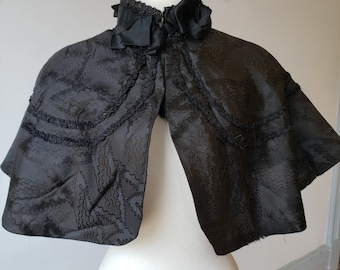 "1890s, 38"" across shoulders, black silk shoulder cape"