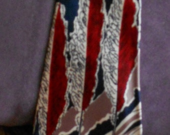 "1940's, 48"" long, dark blue satin tie, with a graduated design of abstract gray palm trees and surf in red"