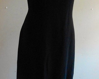 "1960's, 36"" bust, black crepe full length grown, with a band of rhinestones at knee level."