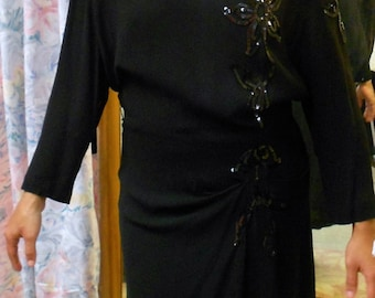 "1940's, 38"" bust, black crape dress, with raglan sleeves"