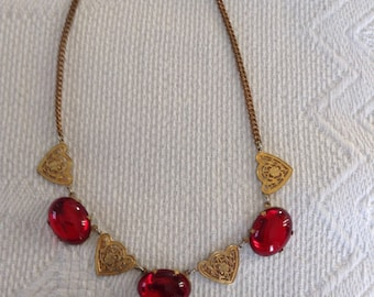 Red glass cabochon stones and 4 gold tone filigree necklace