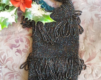 "1920s, 9"" long x4"" wide, hand beaded purse"