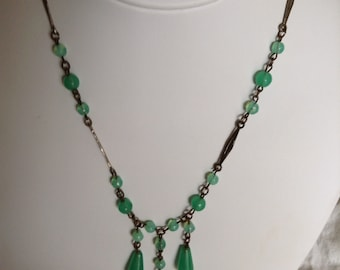 "1930's, 16"" long apple green glass three pendant drop necklace."