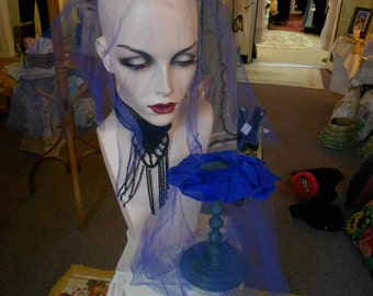 "1950's, 16"" round, silk leaved  crown, bright blue , with wide veil,"