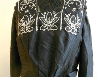 """1910, 40"""" bust, black silk taffeta beaded top (called a waist)."""