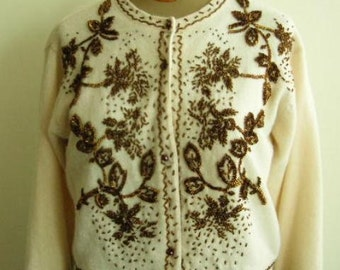 1960's Brown  glass beaded flower swirl motif  on a cream colored lambs and angora wool cardigan