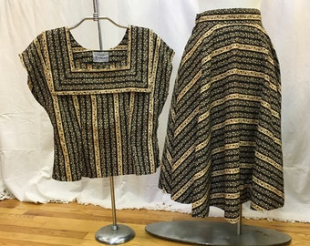 "1950s, 36"" bust, 2 piece cotton print ensemble of gold and black floral print."