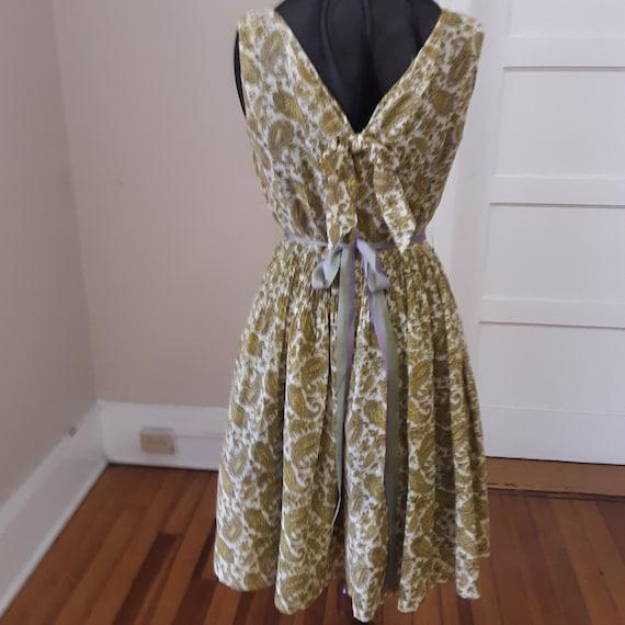 1950s  38 bust, open neckline, sleeveless sun dres