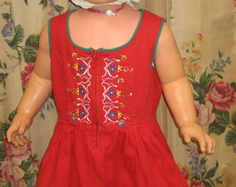 "1950's, 24"" chest, Tyrolean red cotton dress with scooped neckline"