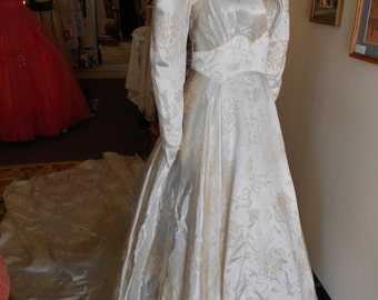 """1940, 32"""" bust, pearl colored, embossed slipper satin, back trained wedding gown"""