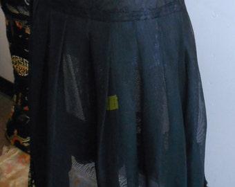 """1950's, 26"""" waist, black petticoat of stiffened nylon netting"""