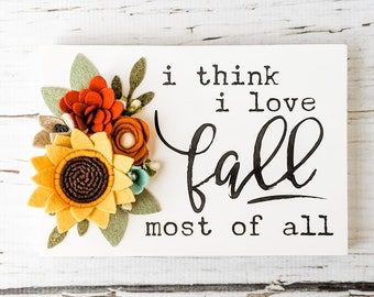 I think I love fall most of all sign with felt flowers