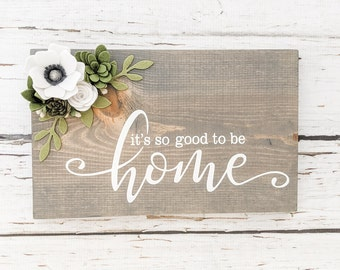 It's so good to be home sign with felt flowers.