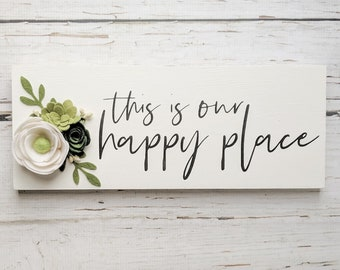 This is our happy place sign with felt flowers