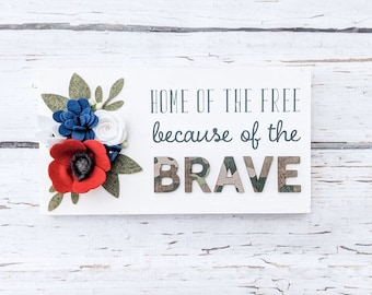 Home of the free because of the brave sign with 3D brave letters