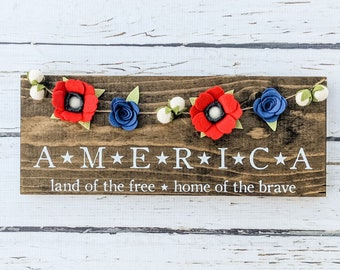 America sign with felt flower garland