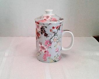 Porcelain Tea/Coffee Mug with an infuser and Lid, World Market.