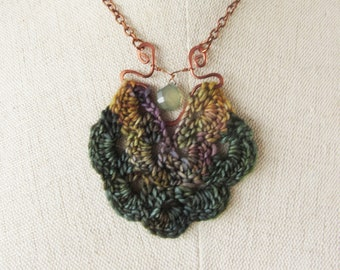 Statement necklace in variegated wool with hammered copper wire-work and semiprecious chalcedony briolette accent