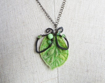 Statement necklace of hand felted wool leaf with hammered gunmetal wire-work and glass beads