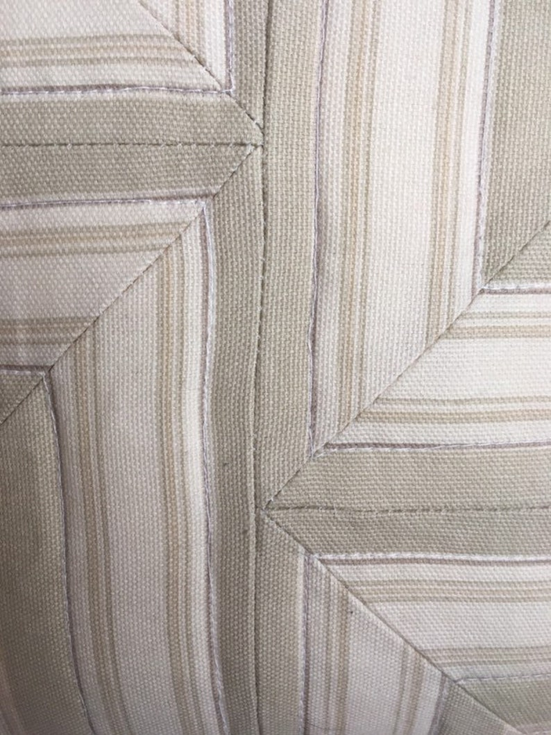 asymmetric design Quilted 16 throw pillow neutral brown earthtone colors