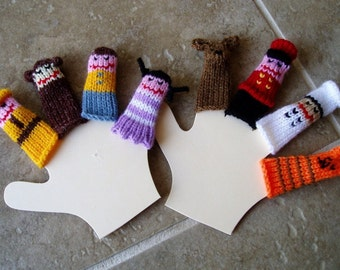 Curious Monkey and Friends Finger Puppet Set (Includes Monkey, Man in Yellow, Boy, Girl, Doorman, Dog, Chef, and Cat.)
