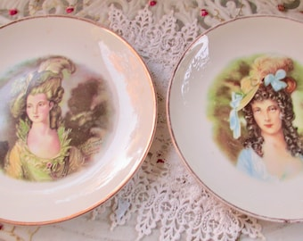 """Two Gains Currough by Jon Peters 8 1/4"""" Plates Victorian Ladies Homer Laughlin"""