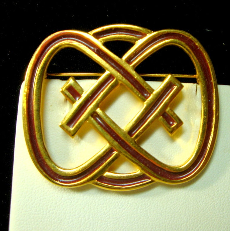 Signed but I cannot read the Name Endless Knot Pin Deep Red Enamel On Matte Goldtone Celtic Brooch SALE