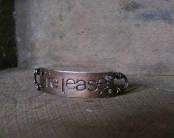 release  -  bracelet plaque in warm copper