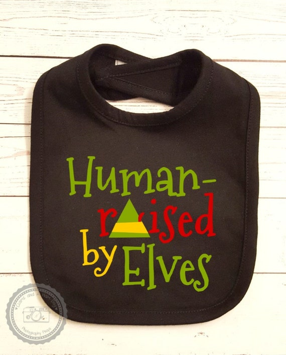 Christmas Bib Elf Movie Quotes Baby Smock Apron Ninny Muggins Smiling Is My Favorite Human Raised By Elves Son Of A Nutcracker Funny