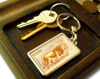 Prowling Lion Keyring - upcycled 1962 Guinea postage stamp