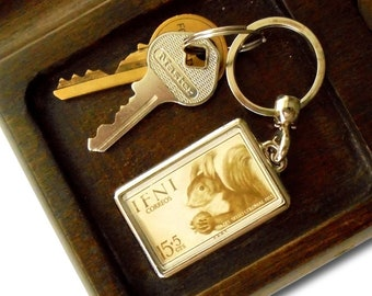 Squirrel with Nut Keyring - upcycled 1955 postage stamp from Ifni