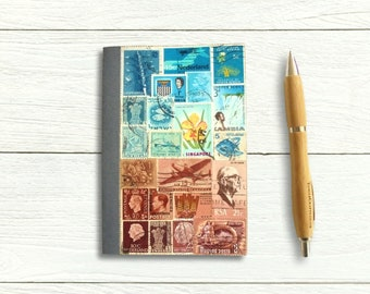Stamp Art Journal Notebook featuring upcycled world stamps in an abstract landscape