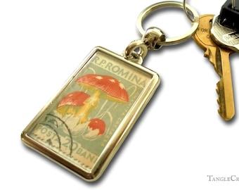 Red & White Mushroom Keychain - upcycled 1958 Romania postage stamp