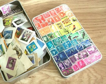 Rainbow Stamp Art Tin Full of Postage Stamps on Paper