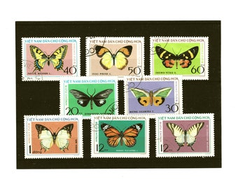 Butterfly postage stamps, 1976 set of 8 from Vietnam, colorful butterflies on used postal stamps, for crafting, card toppers, collection etc